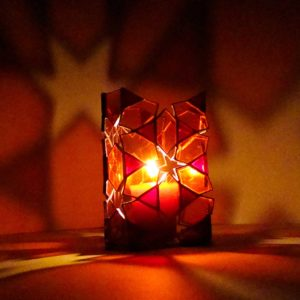 Geometric star Tiffany stained glass candle lantern in red colour.