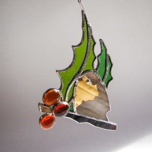 Grey gilded bird with holly, small stained glass suncatcher.