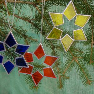 Primary colour stained glass stars christmas tree decoration.