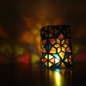 Colourful geometric stained glass candle holder.