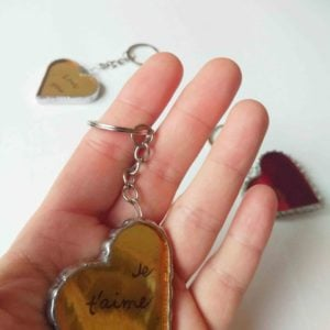 Red gilded stained glass key ring in heart shape.