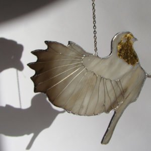 Stained glass grey bird with gilding and wire foot, hanging decor.